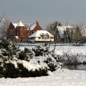 Wintery, snowy view across the Lammas Lands towards Bridge Road, Godalming