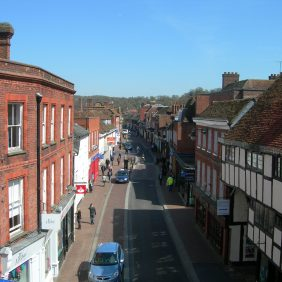 View of Godalming High Street from the top of The Pepperpot with blue skies
