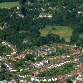 Aerial view of Farncombe showing rooftops and The Manor House at the top of Farncombe Hill