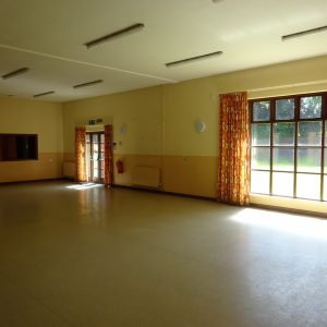 Empty large hall at Broadwater Park Community Centre looking towards the windows and the sunny garden beyond